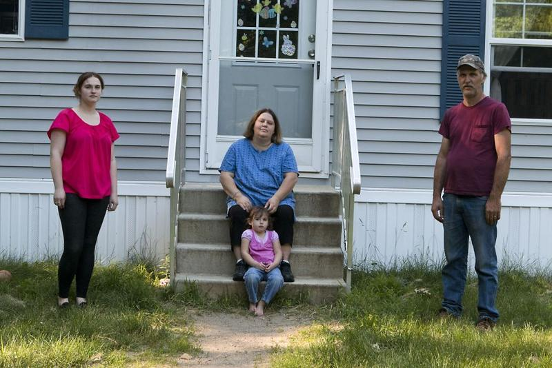 Wendy Brennan, center, outside her home with husband Peter, daughter Caitlyn and granddaughter Madelyn Begin.