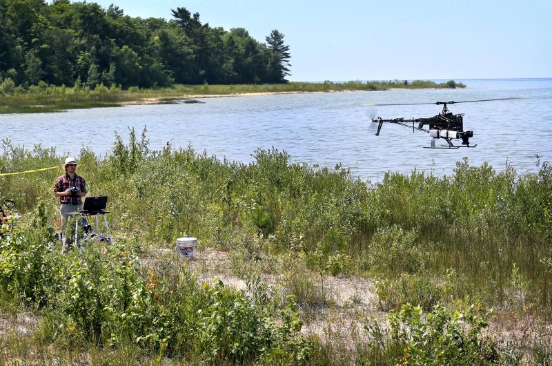 Benjamin Heumann operates the helicopter at Wilderness State Park.