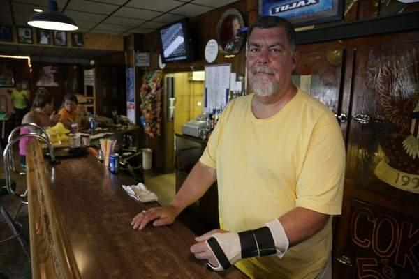 Jack Nadwornik, owner of Tujax Tavern in Delton, was arrested by Barry Township police May 10 and charged with disorderly conduct and resisting arrest. He suffered a broken hand and bloody elbows.