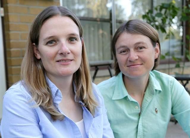 Barbara Webb (left) sitting with wife Kristen Lasecki