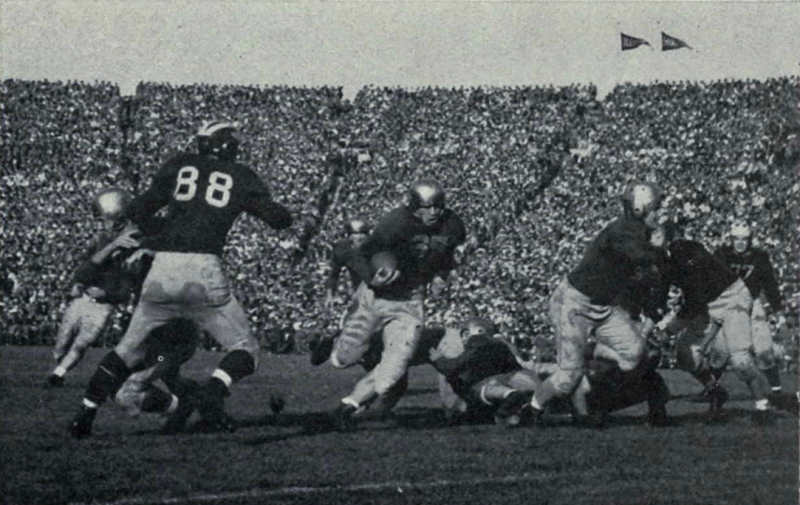Creighton Miller carrying the football for Notre Dame against the 1943 Michigan team. Bob Rennebohm of Michigan (wearing jersey #88) is also pictured.