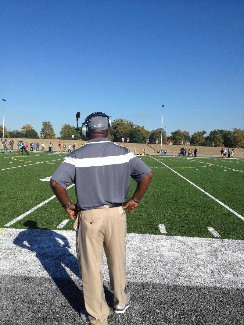 Cody Comets head football coach Calvin Norman, whose day job is working on the assembly line at Detroit Diesel, watching first game on new field