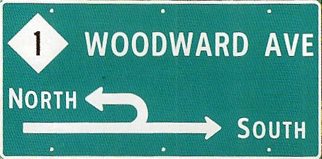 "A sign indicating a ""Michigan Left""."