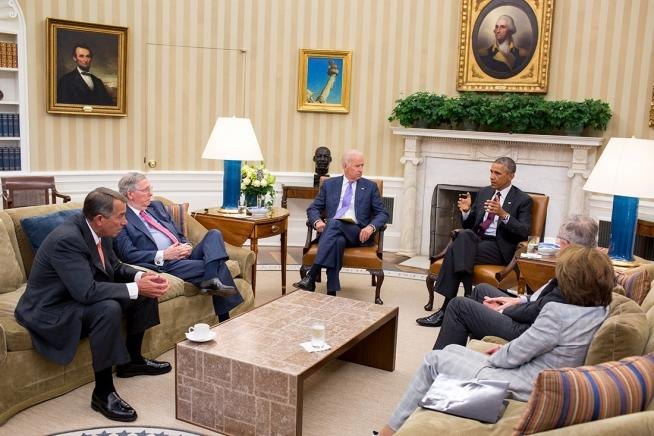 President Obama and Vice President Biden meet with bicameral leadership of Congress regarding foreign policy in the Oval Office, Sept. 9, 2014.