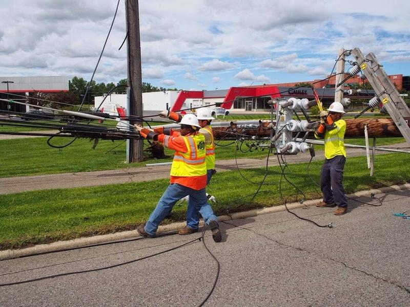 Work being done on Orchard Lake Rd. DTE said more than 2,000 power lines were taken down.