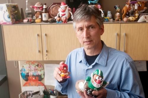 Dave Douches shows some of his potato memorabilia.