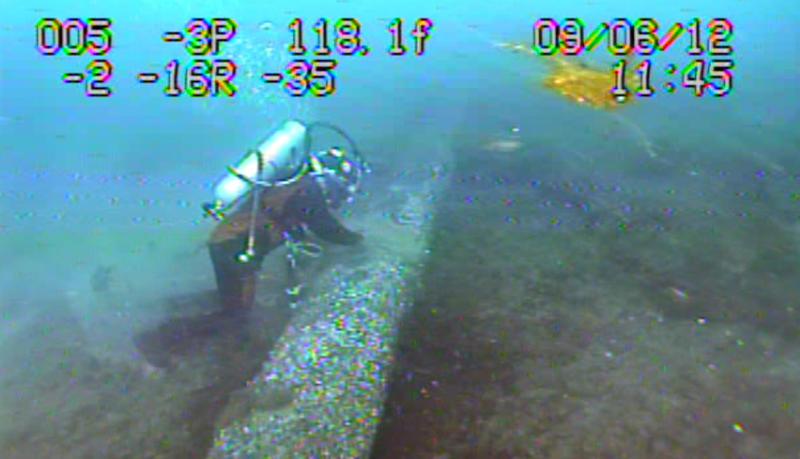 A diver inspects Enbridge's Line 5 pipeline under the Straits of Mackinac for a possible dent.