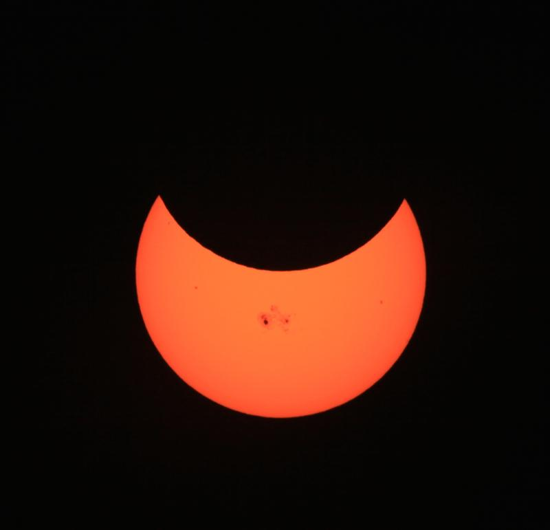"Image of the partial solar eclipse on October 23, 2014. The darkened spots on the sun are ""sun spots,"" regions of cooler surface temperature."