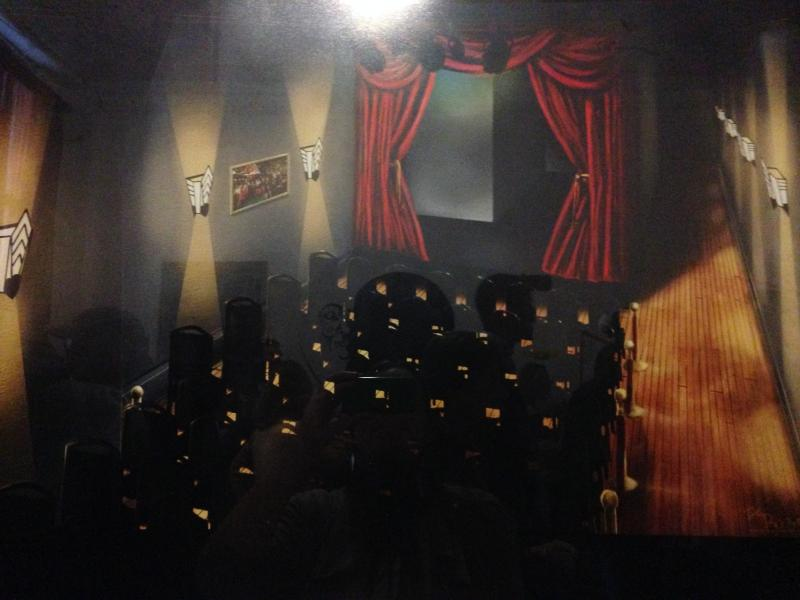 A photo hangs on the wall of what Rogers hopes the Robin Theater will look like in August