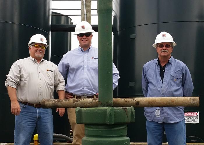 Stallion Oilfield Holdings Attorney Robert Ryan, Regional Vice President Cameron Simon, and Regional Operations Manager Randy Ile at a well pad in Portage County, Ohio.