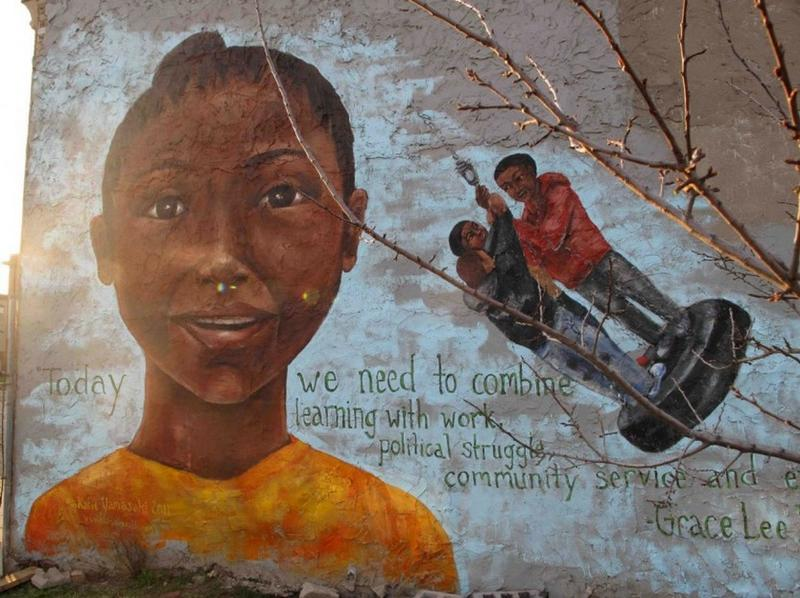 """Today we need to combine learning with work, political struggle, community service and even play."" Boggs mural, by Katie Yamasaki."