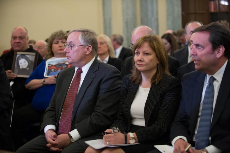 GM CEO Mary Barra, center, at a Congressional subcommittee hearing on the GM ignition switch recall - April 2, 2104.