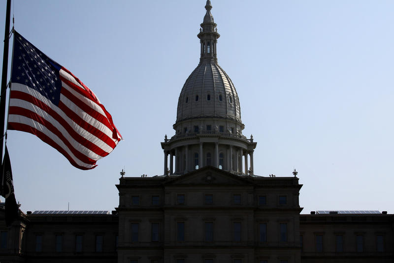 Flag at half-staff near the Capitol in Lansing.