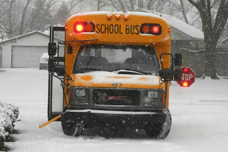 School bus traversing the snow.