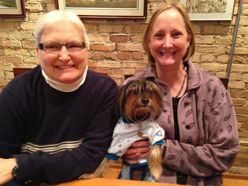 Marsha Caspar and Glenna DeJong with Frizzy. They were the first same-sex couple married in Michigan on March 22, after a federal judge struck down the state's same-sex marriage ban. The ban was restored by the U.S. Sixth Circuit Court of Appeals.