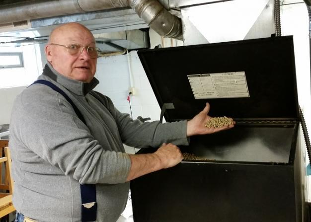 Fred White shows his wood pellet furnace.