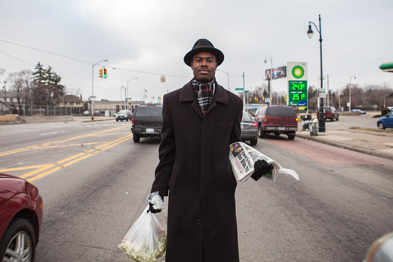 Darryl X. Walker sells produce and newspapers at the corner of Grand River Avenue and Southfield Road.
