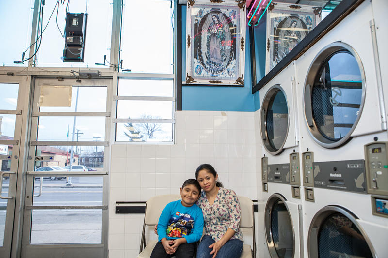 Ulises and his mother, Maria Rodriquez, at Lupita Wash & Dry Laundromats in Mexicantown.