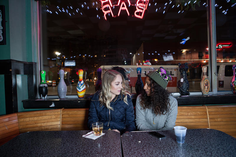 Young women grab a drink at the Magic Stick in Midtown.
