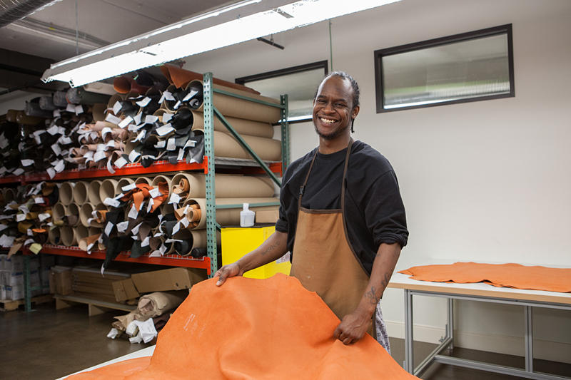 Damon Love works in the leather department at Shinola, New Center.