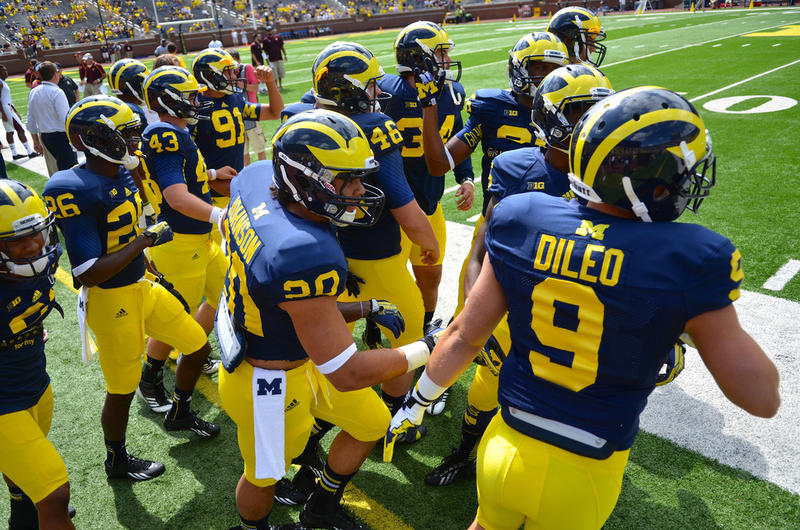 University of Michigan football players take the field.