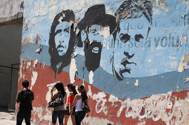 Cuban heroes on a peeling wall in Havana.