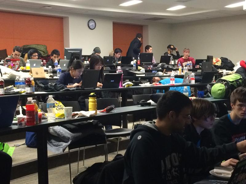 A classroom of students hard at work at MHacks.