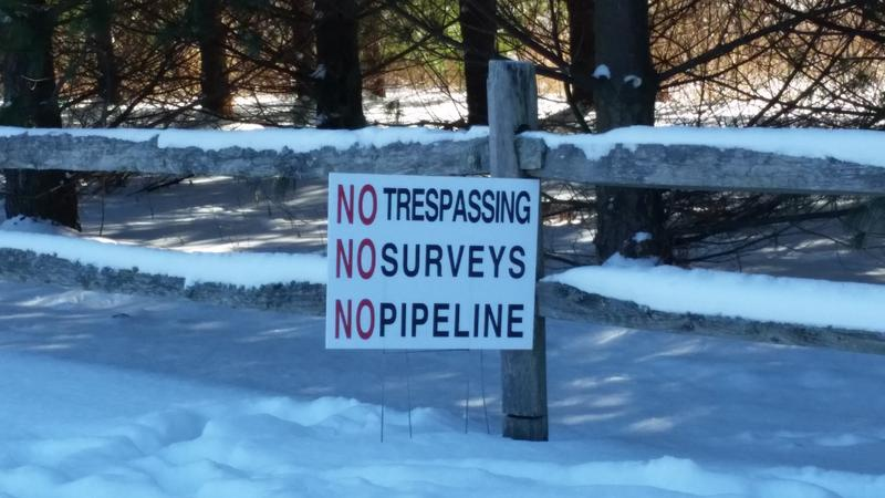 A sign protests the building of a gas pipeline.