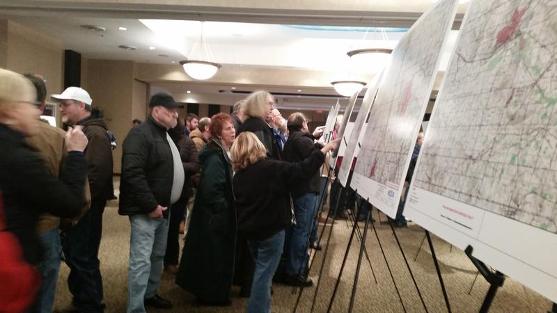 Residents look at maps of a planned pipeline route at a public meeting in Wadsworth, Ohio.