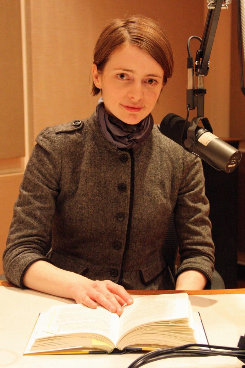 author reading from her book in studio