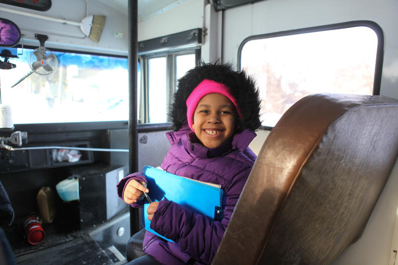 A child from the Springwells community in Southwest Detroit on the bus.