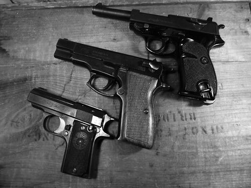 Handguns.