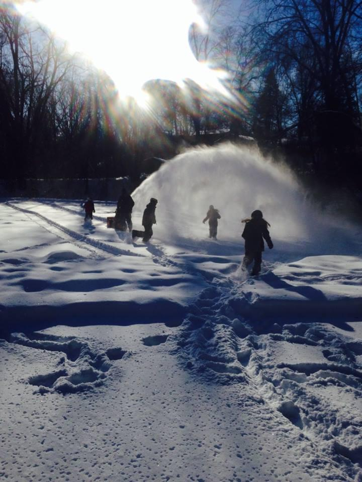Clearing off the pond for hockey in Ann Arbor.