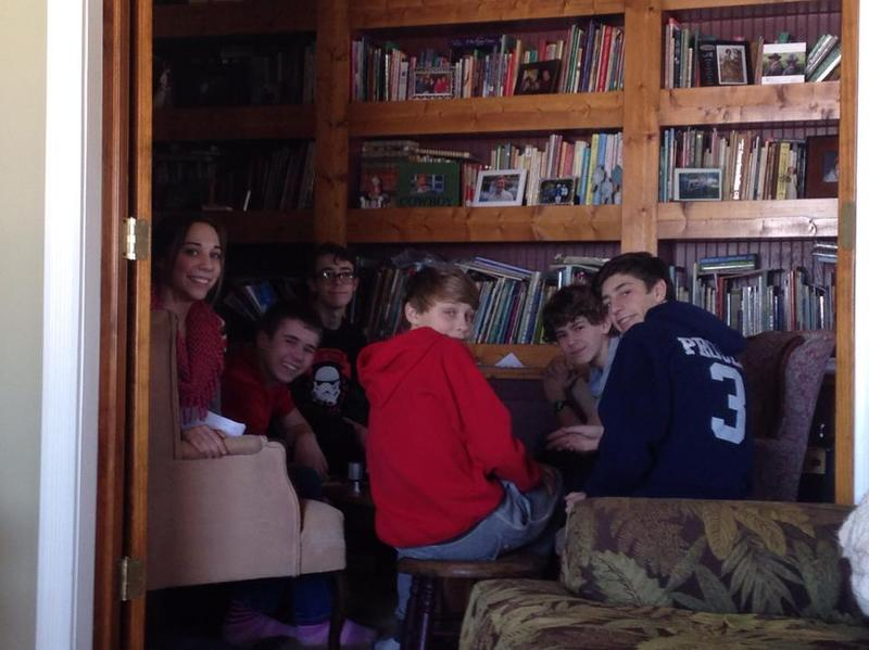 A houseful of teens playing board games.