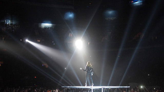 madonna on stage illuminated by spotlights