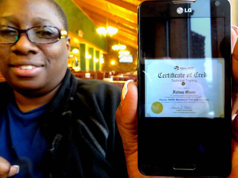 Fatima Mixon shows her Focus: HOPE certificate. She got a job because of the training program.