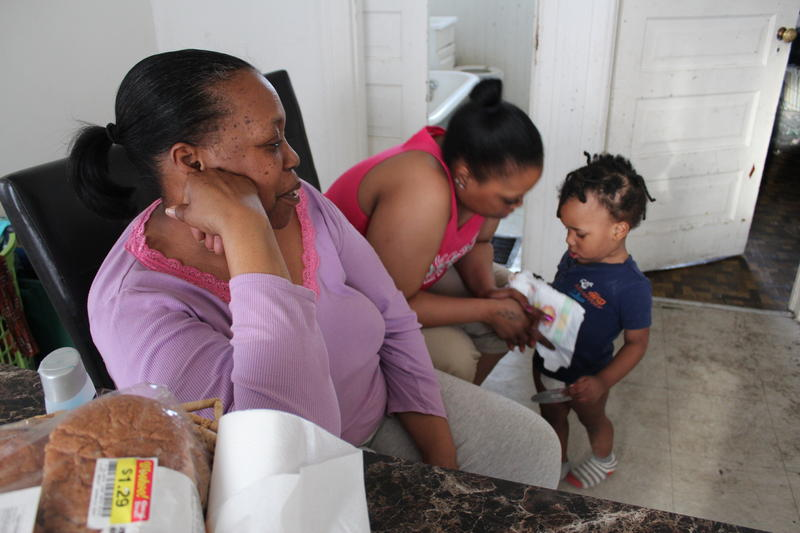 Christina Lumpkin at home with her daughter, Maya and grandson, Jahari.