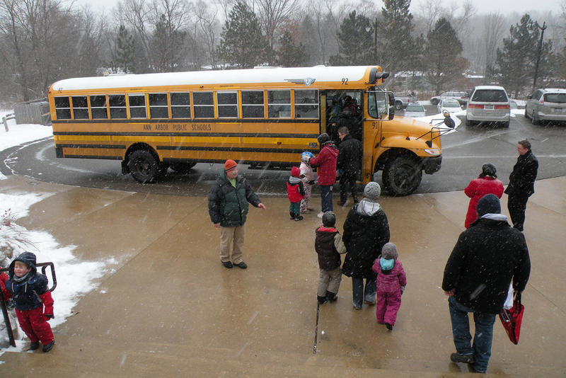 kids going to a school bus
