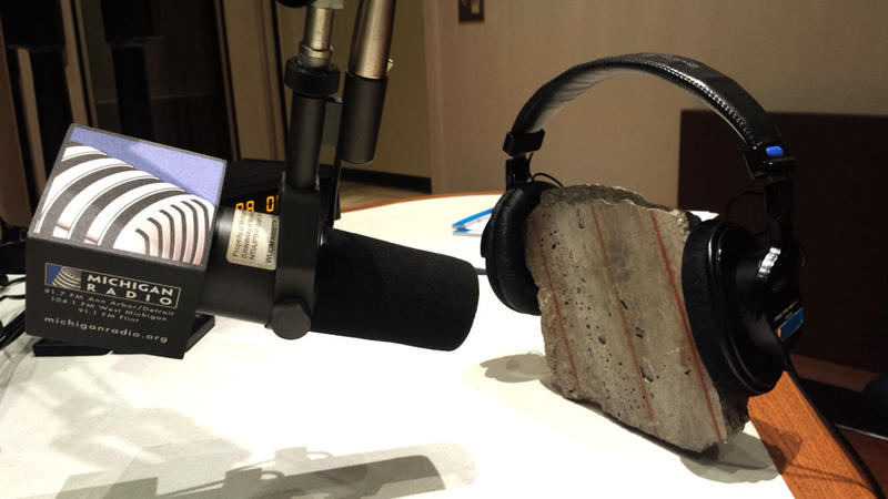 A piece of a Michigan overpass being interviewed on Michigan Radio. Gov. Snyder brought this chunk of road to our studios during our call-in show. The piece of concrete said she's glad to be free from the confinement of the overpass.