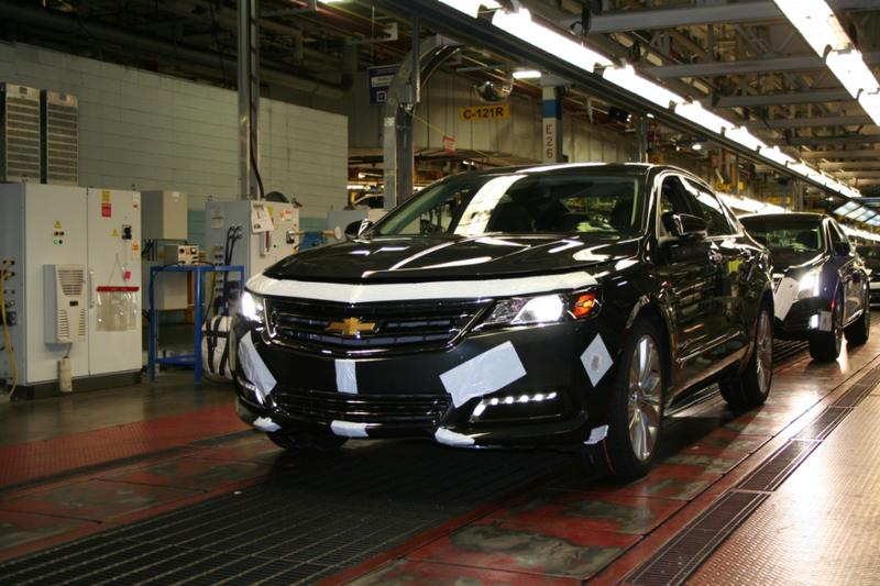 A 2014 Impala on the assembly line driving off the line at Oshawa Assembly.