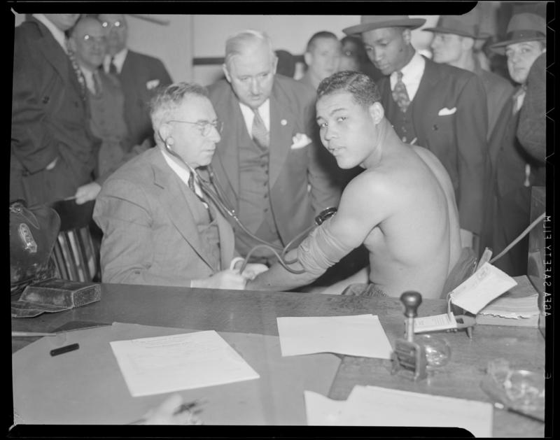 "Joe Louis was the guest of honor at the ""Champions Day"" celebration of 1936."