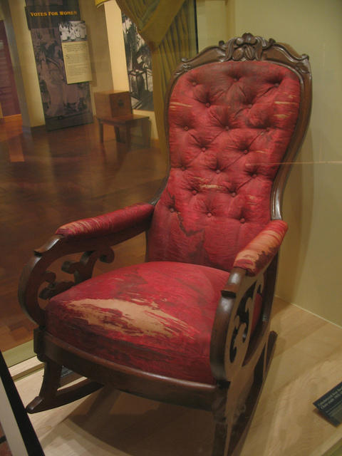 worn red rocking chair
