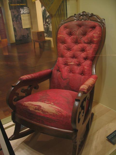 worn red rocking chair
