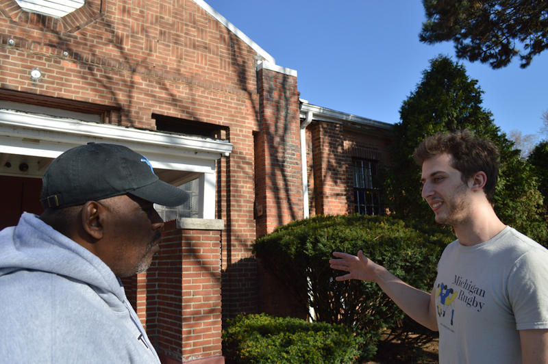 Sam Saunders talks with Paston Semmeal Thomas outside of City Covenant Church.