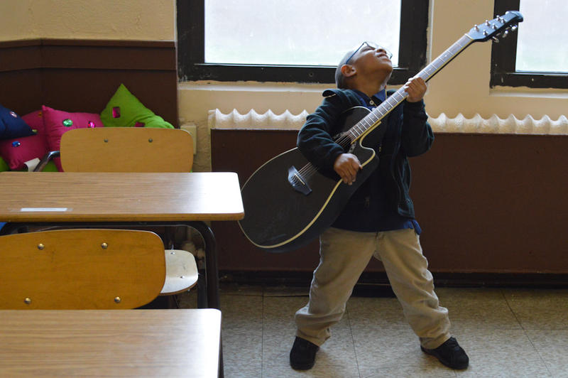 One student at Woodbridge Community Center jams on the guitar.