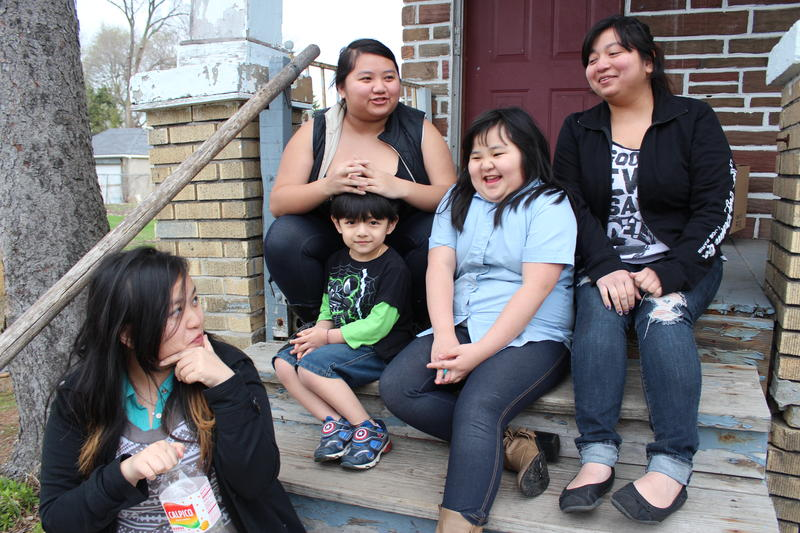Mika Chang (left) with her sisters Bea, Kallia, Shannon and her nephew, Vincent.