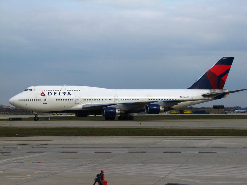 A Delta Air Lines Boeing 747-400 sits on the tarmac at Detroit Metropolitan Wayne County Airport.