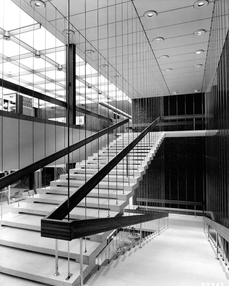 Designed by Kevin Roche, the GM Design lobby staircase is made of 7-foot, 4-inch terrazzo slabs, which overlap each other. The are actually suspended from above. Each tread is caught in tension between pencil-thin stainless steel rods. (4/15/2011)