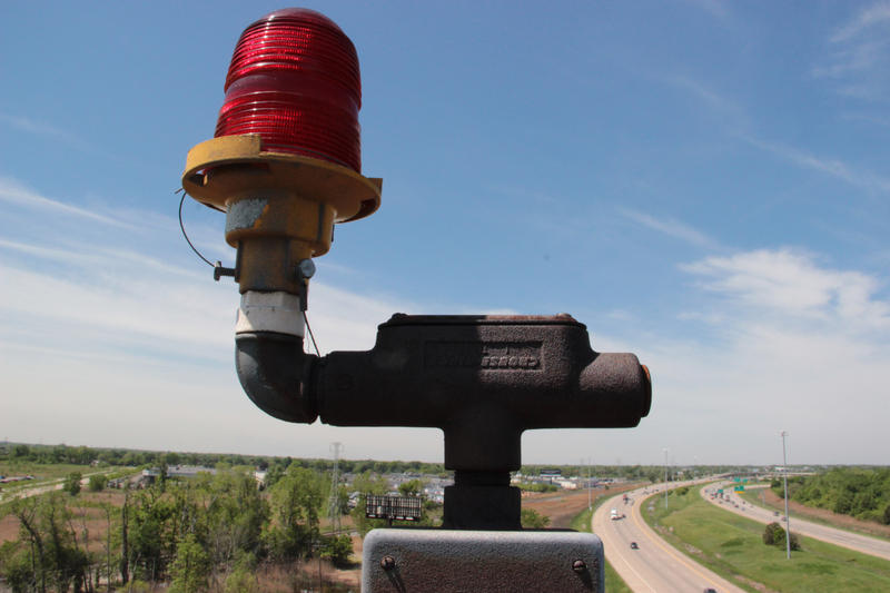 Light for low-flying aircraft atop the Giant Uniroyal Tire.