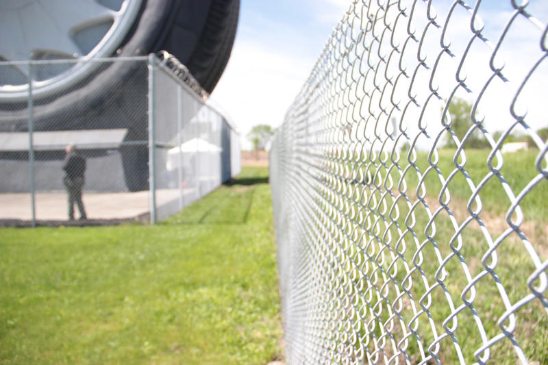Security fence surrounds the tire.